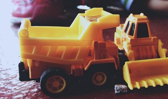 tiny toy dump trucks