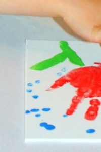 """April Showers Bring May Flowers"" Handprint Art"