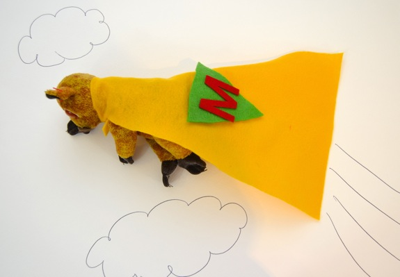 Create a super hero cape for stuffed animals.