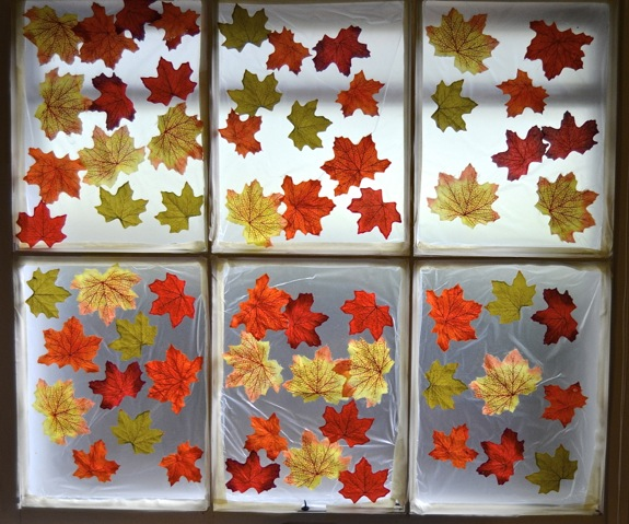 Decorate a window for fall inner child fun for Autumn window decoration